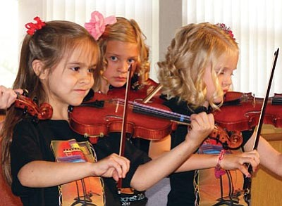 Courtesy photo<br> Young violinists play in the 2011 Chaparral Music Fest's Suzuki Piano and Violin Academy. This year, the youths participating in the festival will perform in a Student Celebration Concert, June 9 at Trinity Presbyterian Church.