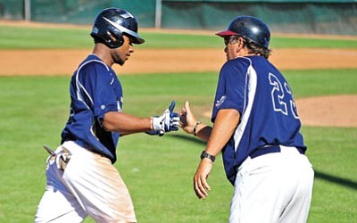 Matt Hinshaw/The Daily Courier<br /><br /><!-- 1upcrlf2 -->Montezuma Federals manager Pete LaCock, right, congratulates Orlando Sandoval for hitting a home run while rounding the bases Saturday afternoon during the Federals' home opener against the Arizona Centennials at Yavapai College in Prescott.