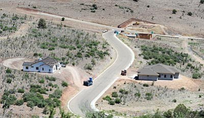 Les Stukenberg/The Daily Courier<br> A number of builders have homes in various stages of construction as home- building in the Yavapai Hills subdivision sees a new growth spurt.