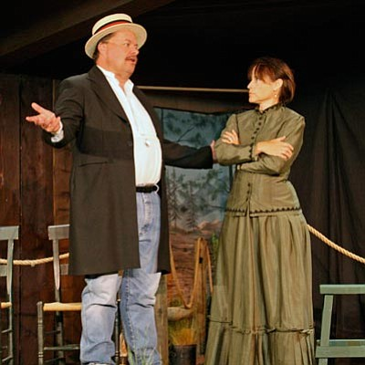"Courtesy photo<br /><br /><!-- 1upcrlf2 -->Arizona Gov. George Hunt (Parker Anderson) and Pauline Schindler O'Neil (Kathy Derry) argue over women's suffrage during a rehearsal for the Blue Rose Theater production ""We Will Vote,"" which opens June 22 at Sharlot Hall Museum."