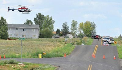 Matt Hinshaw/The Daily Courier<br>A medical helicopter takes off with an injured person near the scene of a motorcycle gang shootout in Chino Valley Aug. 21, 2010.