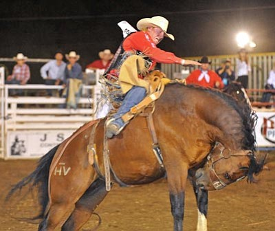 Matt Hinshaw, file/The Daily Courier<br> Taos Muncy of Corona, N.M., competes in Saddle Bronc Riding during the 2010 Frontier Days.Rodeo in Prescott.