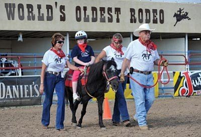 Les Stukenberg, file/The Daily Courier<br>Cait Devereux, 7, of Phoenix, enjoys a horseback ride during the 2009 Happy Hearts Rodeo.