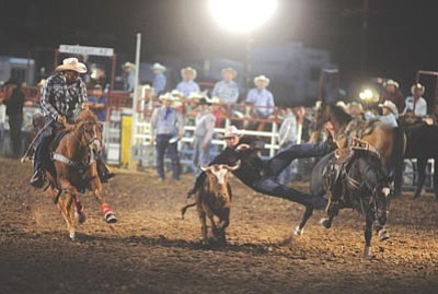 Les Stukenberg/The Daily Courier<br /><br /><!-- 1upcrlf2 -->Riley York had an 8.9-second run in the steer wrestling event during the second performance of the 125th Prescott Frontier Days Rodeo Friday at the Prescott Rodeo Grounds.