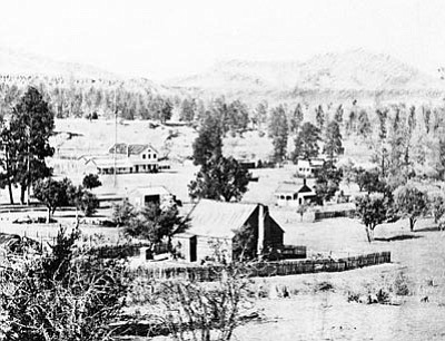 "Sharlot Hall Museum/Courtesy photo<br>""Downtown"" Prescott, circa 1869. If you look closely to the left of the white two-story building, you can see the 144-foot pine flagstaff (no flag on this photo), which was erected in 1864 on the plaza for the first Fourth of July celebration. The two-story white building is the Diana Saloon, which stood on the corner where the Hotel St. Michael stands today."