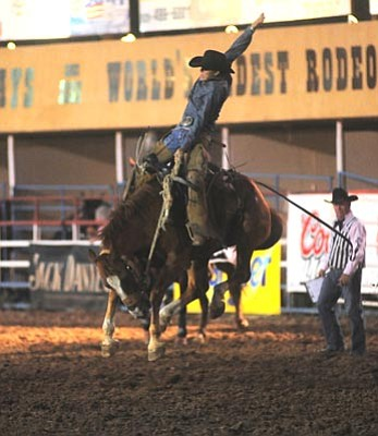 Les Stukenberg/The Daily Courier<br> Huckleberry Sandsness competes in the Cowpuncher's Bronc Riding during the fifth performance of the 125th Prescott Frontier Days Rodeo Thursday at the Prescott Rodeo Grounds.