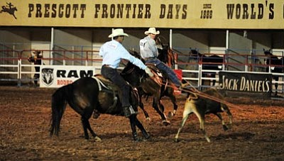 Les Stukenberg/The Daily Courier<br> Tom RIchards and Nick Sarchett kept up their hot streak with a 7.2 second run in the team roping during the 6th performance of the 125th Prescott Frontier Days Rodeo Monday night in Prescott.
