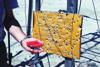BLM/Courtesy photo<br>Vandals shot up this sign on Bureau of Land Management property in California.