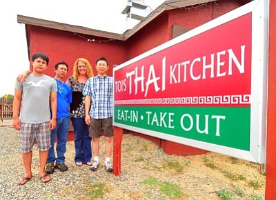 Les Stukenberg/The Daily Courier<br>Toi's Thai Kitchen manager Vicki Roeder poses with fellow workers, from left, Jan Intra, Noi Kittiphot and Jeab Thaweerattanadit at the Prescott Valley restaurant.