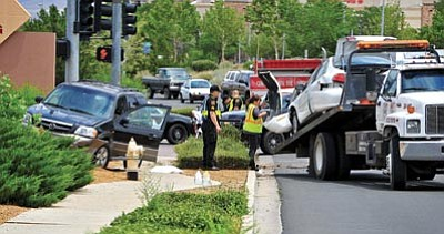 Matt Hinshaw/The Daily Courier<br> Emergency workers begin to clear the scene of a three-vehicle collision at the intersection of Glassford Hill Road and Centre Court Thursday afternoon in Prescott Valley.