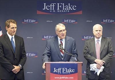 Mark Henle/The Associated Press<br>Sen. John McCain, right, R-Ariz., and Sen. Jon Kyl,  R-Ariz., speaking, endorse Rep. Jeff Flake, R-Ariz., left, for the Republican Senate primary during a news conference in Phoenix Friday.