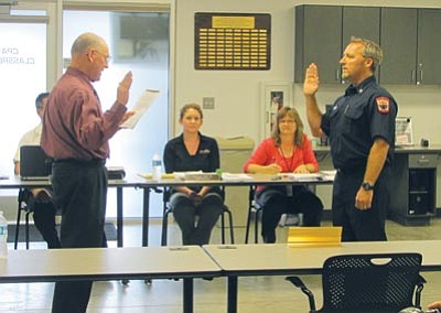 Central Yavapai Fire District's Rick Chase, above, Marc Mazzella, below, and Matt McFadden, bottom, were sworn into new duties Monday.<br> <br> Lisa Irish/ The Daily Courier