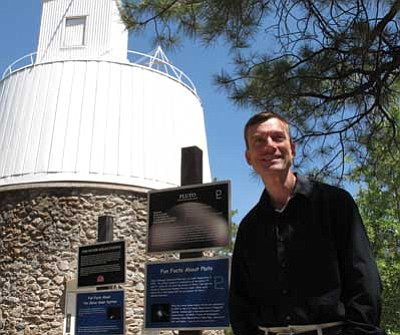 Felicia Fonseca/The Associated Press<br> This June 11, 2012, photo shows Jeff Hall, director of Lowell Observatory, on the campus in Flagstaff. The observatory has unveiled the $53 million Discovery Telescope, the fifth largest in the continental U.S.