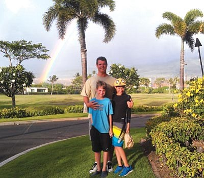 Courtesy photo<br> Craig Woods poses with his sons in Honolulu, Hawaii.