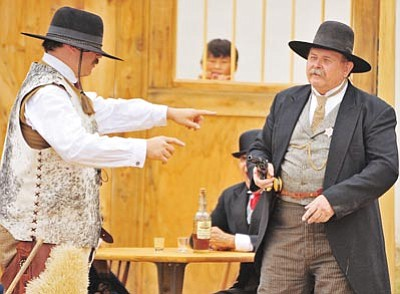 Matt Hinshaw/The Daily Courier<br>Members of the Arizona Ghostriders re-enactment group perform a comedy skit for the judges and crowd Saturday morning during the 7th annual Whiskey Row Shootout in Prescott.
