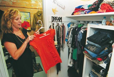 Les Stukenberg, file photo/The Daily Courier<br>  Krystal Koons shows off a girl's skirt at the Teens' Closet, a boutique for teenagers who have no money to buy clothing and accessories.