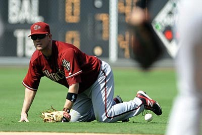 Michael Perez/The Associated Press<br> Arizona Diamondbacks' Aaron Hill drops the ball and cannot make the play to Paul Goldschmidt at first base in the eighth inning of Sunday's game against the Phillies in Philadelphia. The Phillies won 5-4.
