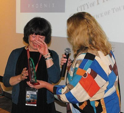 """Scott Orr/The Daily Courier<br> Canadian filmmaker Shelagh Carter tearfully accepts her award for the Jury Award, Best Narrative Feature, for her film, """"Passionflower"""" at the Prescott Film Festival on Sunday."""