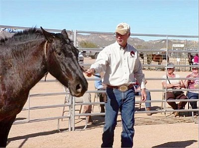 Courtesy BLM<br> Randy Helm shows potential wild horse and burro owners how to gently train a horse. Those who adopt a wild horse will have the opportunity to view a gentling demonstration featuring expert trainers.