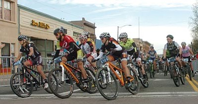 Les Stukenberg/The Daily Courier<br> Racers hit the first corner at the Whiskey Off-Road 50 Proof along Whiskey Row in downtown Prescott April 28.