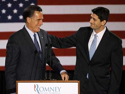 M. Spencer Green, File/The AP<br> House Budget Committee Chairman Rep. Paul Ryan, R-Wis. introduces Republican presidential candidate, former Massachusetts Gov. Mitt Romney before Romney spoke at the Grain Exchange in Milwaukee, in this April 3, 2012 file photo.