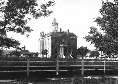 Sharlot Hall Museum/ Courtesy photo<br> The first Yavapai County Courthouse, photographed circa 1880, was built after some legal wrangling and a final decision to keep the plaza for public use instead of parceling it out as lots for building.