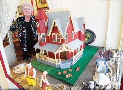 Les Stukenberg/The Daily Courier<br>Eve Anne Colucci opened Aviance Buy & Sell Antiques at 141 N. Cortez St. on July 22.