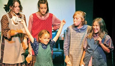 """Matt Hinshaw/The Daily Courier<br>""""Annie"""" cast members sing """"It's a Hard-Knock Life"""" Saturday during the Prescott Center for the Arts' 2012–2013 season kickoff and volunteer appreciation event."""