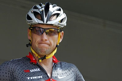 Christophe Ena/The Associated Press<br>Lance Armstrong said Thursday that he is finished fighting charges from the United States Anti-Doping Agency that he used performance-enhancing drugs during his unprecedented cycling career.