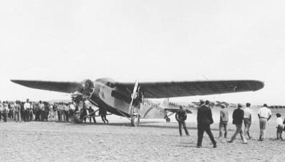 Sharlot Hall Museum/Courtesy photo<br>Officials position the Scenic Airways Ford tri-motor at the re-dedication and naming of Ernest A. Love Field on Aug. 26, 1928.