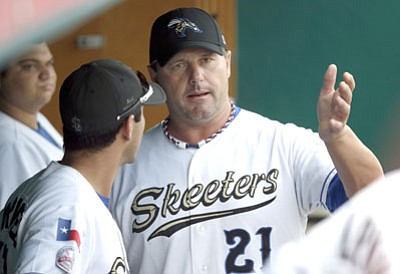 David J. Phillip/The Associated Press<br>Sugar Land Skeeters pitcher Roger Clemens (21) talks with catcher Octavio Martinez, left, before the Skeeters' game last Friday.