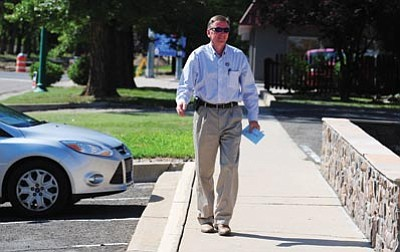 Les Stukenberg/The Daily Courier<br> United States Congressman Paul Gosar arrives at the Mount Vernon Church of Christ in Prescott to drop off his ballot for Tuesday's primary election.