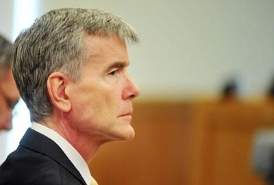 Les Stukenberg/The Daily Courier, file<br>Steven Democker sits stoically during the opening statements of his trial on June 3, 2010.