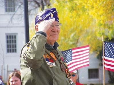 Courtesy photo<br>Ret. U.S. Army Major John Reyna Tapia salutes during the 2006 Veterans Day Parade at the Bob Stump Veterans Affairs Medical Center.