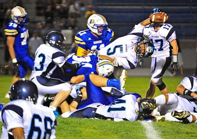 Matt Hinshaw/The Daily Courier<br>Deer Valley QB Mageo Zack reaches for his team's first touchdown of the game Friday night Prescott. But the Prescott Badgers were in total control otherwise.