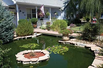 Courtesy photo<br> Mike and Julie Clapp have been working on their little slice of paradise, which includes a koi pond, since moving to this Chino Valley home five years ago.