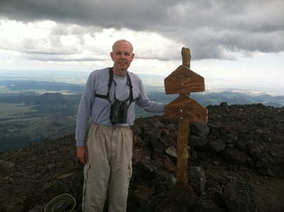 Eric Moore/Courtesy photo<br /><br /><!-- 1upcrlf2 -->Eric Moore at the top of Humphreys Peak<br /><br /><!-- 1upcrlf2 -->