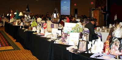 """Courtesy photo<br>The """"Runway of Bags"""" features 100 bags that guests will win in either a silent auction or a raffle that will be highlights of the AWEE Baubles, Bags & Bling luncheon on Thursday."""