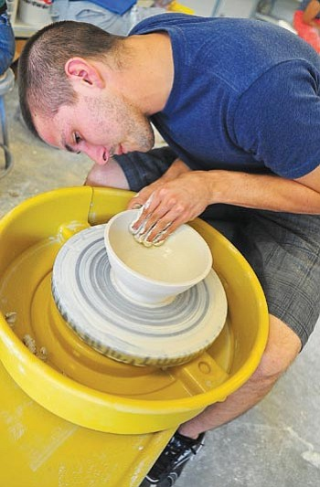 Matt Hinshaw/The Daily Courier<br> Yavapai College fine arts major Matthew Kaminski molds a bowl Aug. 25 in Prescott. Students and volunteer potters came together to fashion about 300 bowls to donate to Empty Bowls, an event that helps feed the hungry.