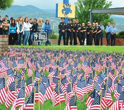 Les Stukenberg/The Daily Courier<br> Prescott Police, Fire and students attend the 9/11 memorial ceremony at Prescott High School, Tuesday, on PHS's front lawn. The event was organized by the PHS Student Council and Air Force Junior Officer Training Corps cadets.