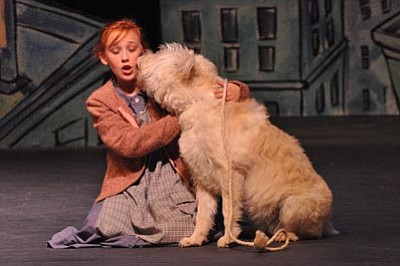 "Dave Cottle/Courtesy photo<br> Annie gets a kiss from her stray dog Sandy in ""Annie,"" the Prescott Center for the Arts' production that opens Friday at the Yavapai College Performing Arts Center."