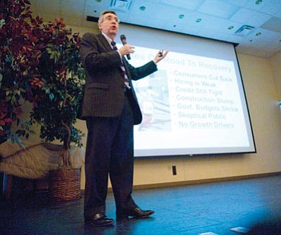 Les Stukenberg/The Daily Courier<br>Lee McPheters, director of the JPMorgan Chase Economic Outlook Center and research professor of economics at ASU, speaks on the state of the economic recovery at the Rowle P. Simmons Community Center Wednesday.