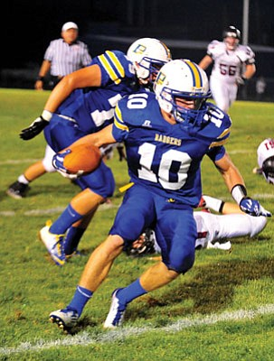Matt Hinshaw/The Daily Courier<br>Brady Mengarelli, seen in earlier action this season, so far has 1,055 rushing yards and 13 rushing TDs in four games in 2012.