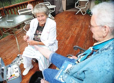 Les Stukenberg/The Daily Courier<br>Foot Angel founder Betty Berger works on Edna Evans' feet in Prescott Monday. Berger is retiring and her daughter, Keli Kelly, and granddaughter Jennie Schuler will run the mobile foot care business.