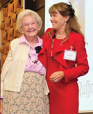 Les Stukenberg/The Daily Courier<br>Sheila Polk, right, congratulates Elisabeth Ruffner on her receiving the Barbara Polk Spirit of Volunteerism Award at AWEE's annual luncheon Thursday.