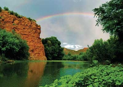 """AWC/Courtesy photo<br> A still from """"Viva La Verde!"""" features a rainbow over the Upper Verde River and its canyon."""