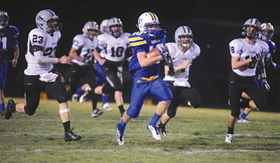 Les Stukenberg/The Daily Courier<br>Brady Mengarelli turned in his most dominating performance yet of the season Friday night, and pushed his season rushing yardage total to 1,407.