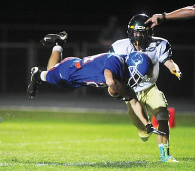Les Stukenberg/The Daily Courier<br>Tory Marciel of the Cougars dives in for a touchdown in the first half during Friday night's homecoming game against Mohave in Chino Valley.