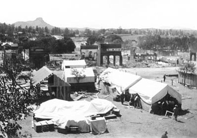 "Sharlot Hall Museum/Courtesy photo<br>In July 1900, after Whiskey Row burned down, merchants set up temporary businesses in a ""tent city"" on the courthouse plaza until rebuilding was complete. Center is what was left of the Palace Saloon. It was rebuilt on the same site and is located there today."