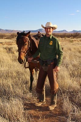Ivie Family, Cole Kynaston/The Associated Press<br>Border Patrol Agent Nicholas Ivie poses in an undated photo.